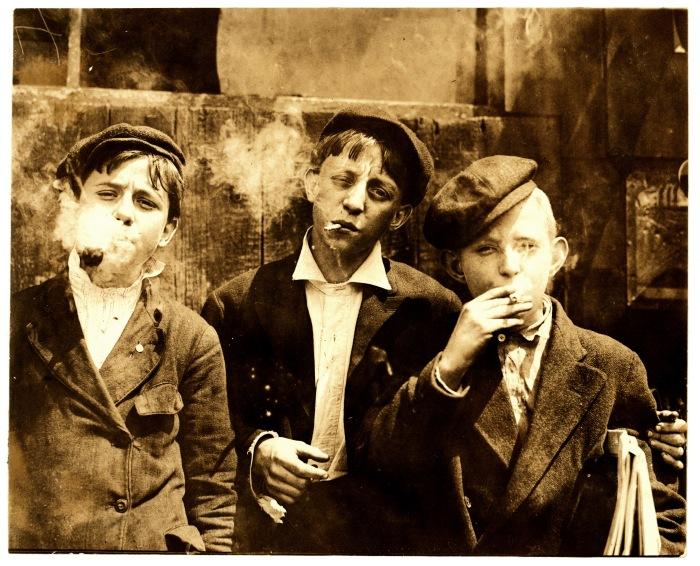 lewis_hine_newsies_smoking_at_skeeters_branch_st-_louis_1910